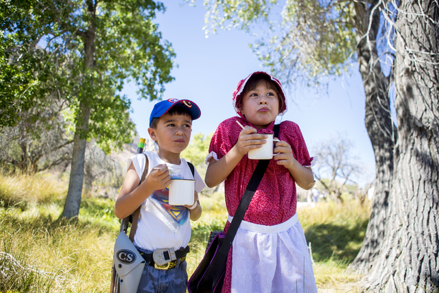 Edwin Stewart,6, left, and Emmaline Stewart, 8, pinch their faces after taking a bite of the freshly made dutch oven cooked pot pie during Pioneer Day at Spring Mountain Ranch State Park in Las Ve ...