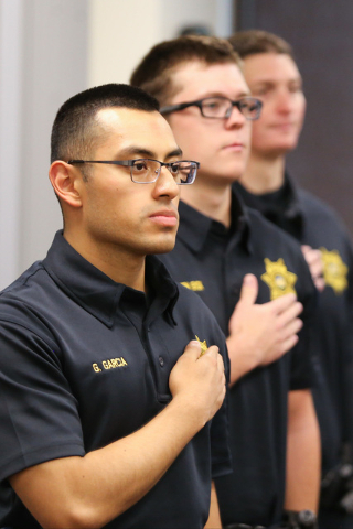 Police academy students recite the Pledge of Allegiance during a panel discussion on the legalization of marijuana at the University of Phoenix in Las Vegas on Saturday, Sept. 10, 2016. Brett Le B ...