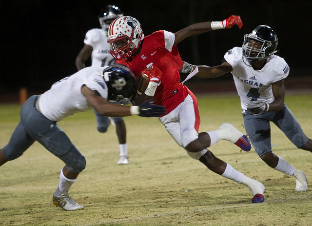 Liberty wide receiver Marquez Powell (1) carries the ball against Desert Pines players during a varsity football game at Liberty High School in Henderson on Thursday, Sept. 15, 2016. Richard Brian ...