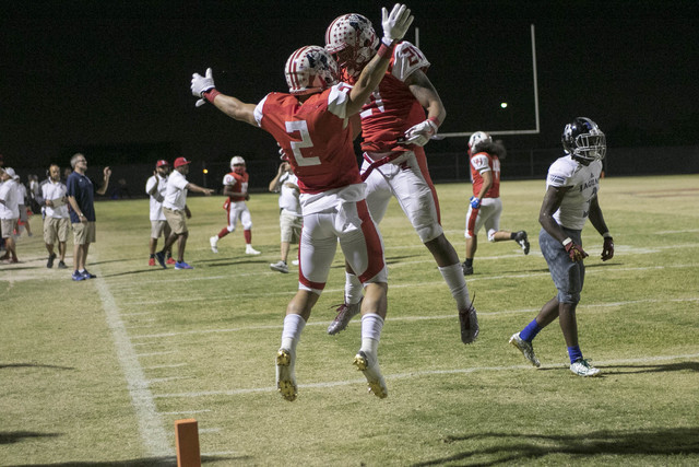 Liberty's Ethan Dedeaux (2) celebrates with teammate Darion Acohido (21) after scoring a touchdown against Desert Pines during a varsity football game at Liberty High School in Henderson on ...