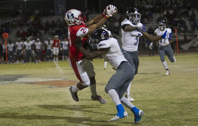 Libertyճ Darion Acohido (21) catches a pass over Desert Pines' Andrew Gray (8) during a varsity football game at Liberty High School in Henderson on Thursday, Sept. 15, 2016. Richard Brian/L ...
