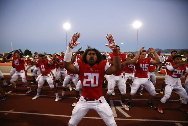 Libertyճ Tamakave Tai (20) leads his teammates with a Samoan siva tau war dance before playing Desert Pines in a varsity football game at Liberty High School in Henderson on Thursday, Sept.  ...