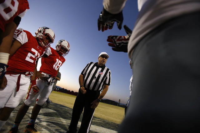 A referee prepares for the coin toss before the Liberty and Desert Pines varsity football game at Liberty High School in Henderson on Thursday, Sept. 15, 2016. Richard Brian/Las Vegas Review-Journ ...