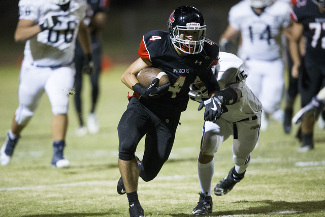 Las Vegas' Nick Sablan (4) runs the ball for a gain of yards in their football game against Centennial at Las Vegas High School on Friday, Sept. 16, 2016, in Las Vegas. Las Vegas won 24-21. Erik V ...