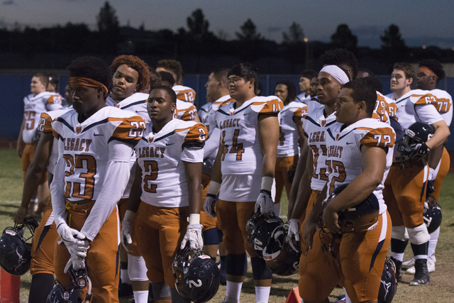 """Legacy players line up for """"The Star-Spangled Banner"""" during a football game at Centennial in Las Vegas, Friday, Sept. 30, 2016. Jason Ogulnik/Las Vegas Review-Journal"""