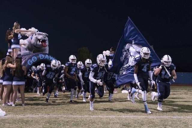 Centennial players take the field during a football game against Legacy at Centennial in Las Vegas, Friday, Sept. 30, 2016. Jason Ogulnik/Las Vegas Review-Journal