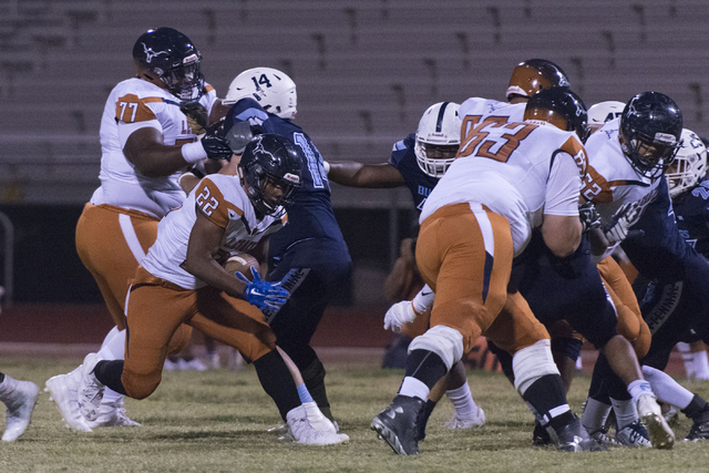 Legacy's Samuel Turner (22) runs with the ball during a football game at Centennial in Las Vegas, Friday, Sept. 30, 2016. Jason Ogulnik/Las Vegas Review-Journal