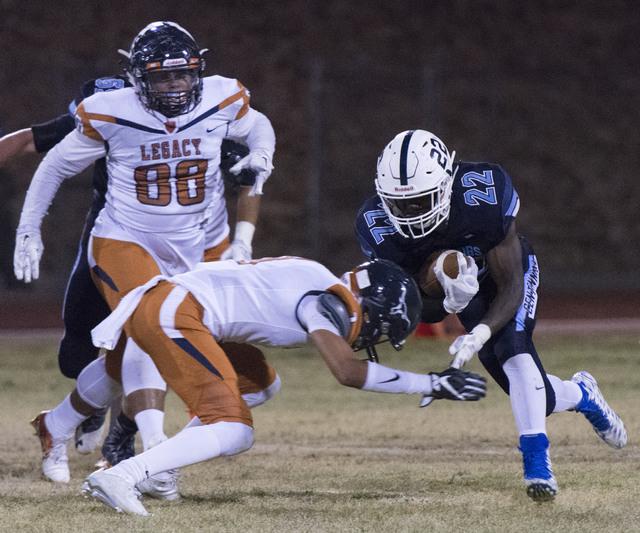 Centennial's Kayvon Miller (22) runs with the ball during a football game against Legacy at Centennial in Las Vegas, Friday, Sept. 30, 2016. Jason Ogulnik/Las Vegas Review-Journal