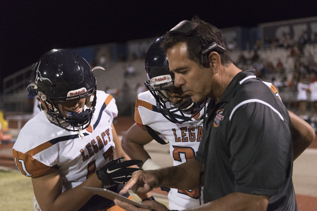 Legacy players review a play during a football game at Centennial in Las Vegas, Friday, Sept. 30, 2016. Jason Ogulnik/Las Vegas Review-Journal