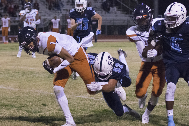 Legacy's Jamaal Britt (1) is tackled during a football game at Centennial in Las Vegas, Friday, Sept. 30, 2016. Jason Ogulnik/Las Vegas Review-Journal