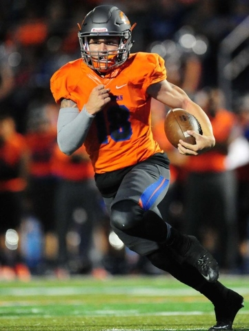 Bishop Gorman quarterback Tate Martell rushes for a first down against Cocoa, Fla,. in the first half of their prep football game at Bishop Gorman High School in Las Vegas Friday Sept. 2, 2016. Jo ...
