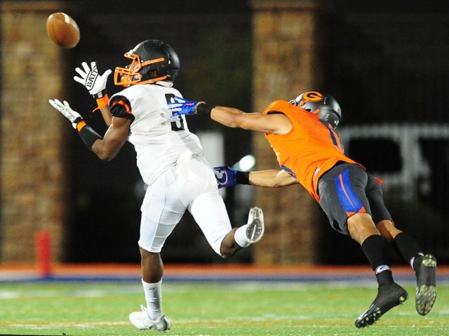 Cocoa, Fla., running back Javian Hawkins catches a touchdown pass in front of Bishop Gorman safety Bubba Bolden in the first half of their prep football game at Bishop Gorman High School in Las Ve ...
