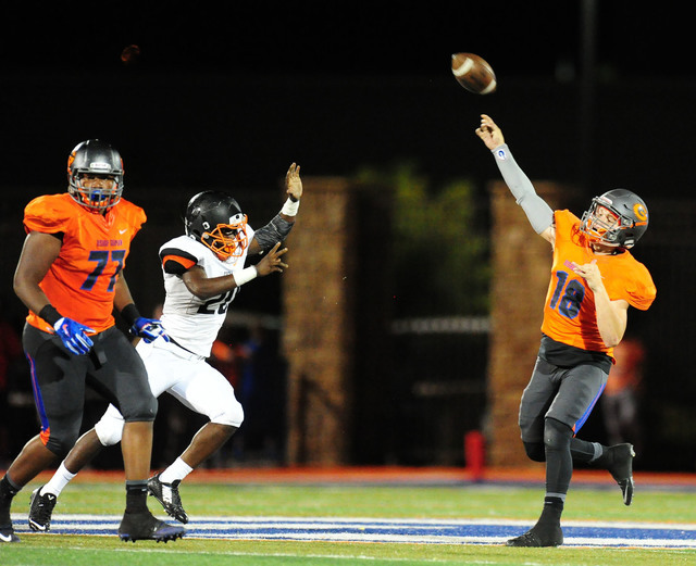 Bishop Gorman quarterback punter Tate Martell  throws a hail Mary touchdown pass while time expires in the first half of their prep football game against Cocoa, Fla., at Bishop Gorman High School  ...