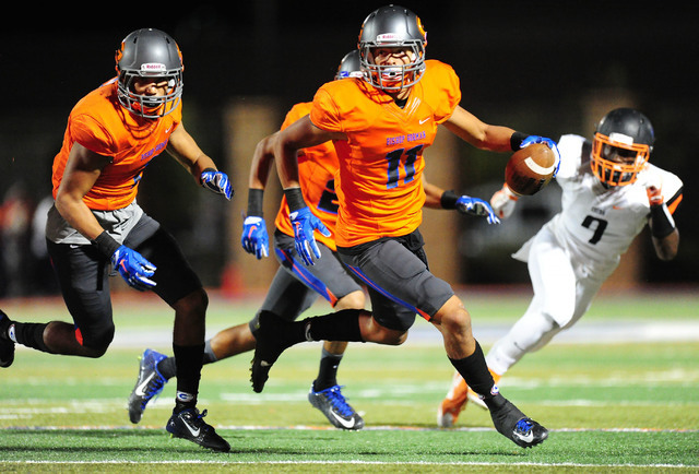 Bishop Gorman safety Bubba Bolden returns an interception for touchdown against Cocoa, la., in the second half of their prep football game at Bishop Gorman High School in Las Vegas Friday Sept. 2, ...