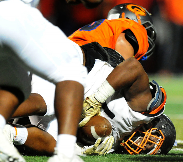 Cocoa, Fla., defensive end Howard Stewart recovers a Bishop Gorman fumble in the second half of their prep football game at Bishop Gorman High School in Las Vegas Friday Sept. 2, 2016. Bishop Gorm ...