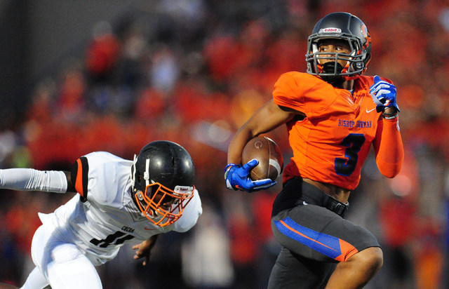Bishop Gorman wide receiver Jalen Nailor scores a touchdown reception in front of Cocoa, Fla., defensive back Jaleel Henry in the first quarter of their prep football game at Bishop Gorman High Sc ...