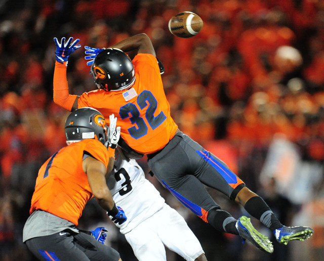 Bishop Gorman coronrback JoJuan Claiborne (32) breaks up a pass intended for Cocoa, Fla., running back Javian Hawkins in the second half of their prep football game against Cocoa, Fla., at Bishop  ...