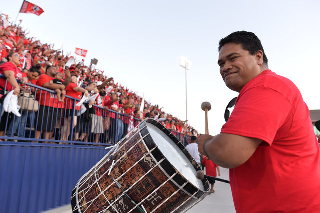 A Kahuku High School supporter beats a drum as fans cheer while Kahuku enters the field during the Bishop Gorman High School Kahuku High School game at Bishop Gorman in Summerlin on Saturday, Sept ...