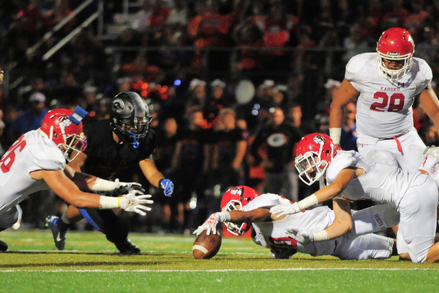 Players from Bishop Gorman and Kahuku battle for a loose ball after a Kahuku fumble during the Bishop Gorman High School Kahuku High School game at Bishop Gorman in Summerlin on Saturday, Sept. 17 ...