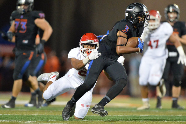 Bishop Gorman receiver Jalen Nailor (3) tries to break a tackle from Kahuku safety Codie Sauvao (23) during the Bishop Gorman High School Kahuku High School game at Bishop Gorman in Summerlin on S ...