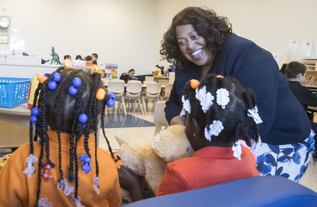 Deputy Assistant Secretary with the U.S. Department of Education Monique Chism, from left, speaks with Lyris Miles and Ta'niyah Moore, both 4, at Mater Academy of Nevada in Las Vegas on Thursday,  ...