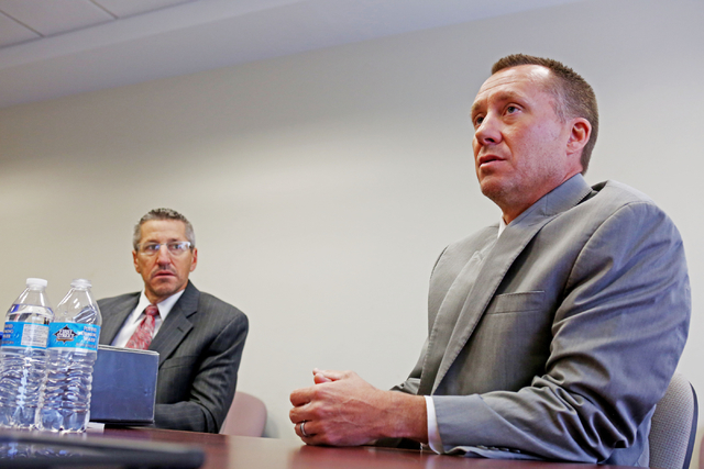 Chairman of the Gaming Control Board A.G. Burnett, right, and Chief of Investigations Mike LaBadie discuss security and anti-money laundering, Wednesday, Sept. 7, 2016, at  Grant Sawyer State Offi ...