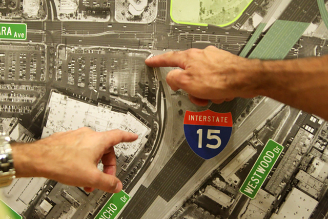 Meeting attendees discuss changes to I-15 on Wednesday, June 10, 2015, in Las Vegas. A public meeting was held regarding the overhaul of the Spaghetti Bowl. (James Tensuan/Las Vegas-Review Journal ...