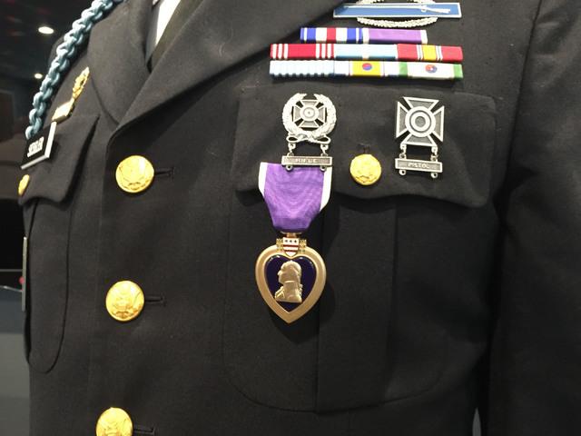 A Purple Heart medal is displayed on the Army uniform of Korean War veteran Warren Sessler following a veterans meeting in Henderson Aug. 24, 2016. (Keith Rogers/Las Vegas Review-Journal)