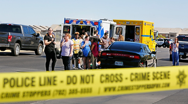 Emergency personnel stand by near Rainbow Blvd. in Las Vegas, Sunday, Sept. 25, 2016, after a shooting inside a Starbucks at a southwest valley strip mall.  (Chitose Suzuki/Las Vegas Review-Journal)