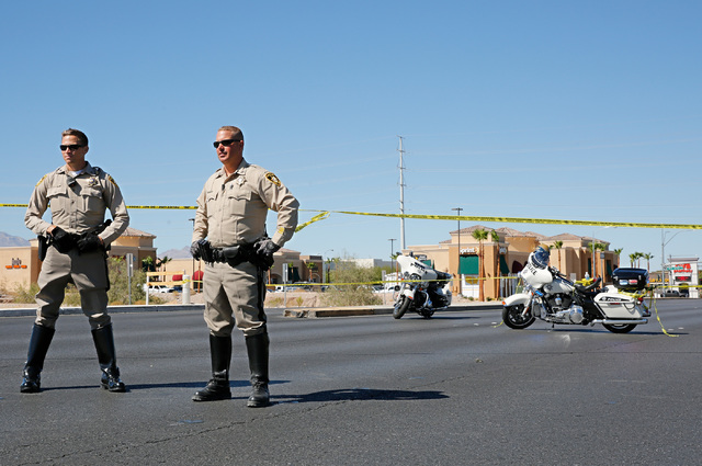 Police officers block off Rainbow Boulevard in Las Vegas, Sunday, Sept. 25, 2016, after a shooting inside a Starbucks at a southwest valley strip mall. (Chitose Suzuki/Las Vegas Review-Journal)