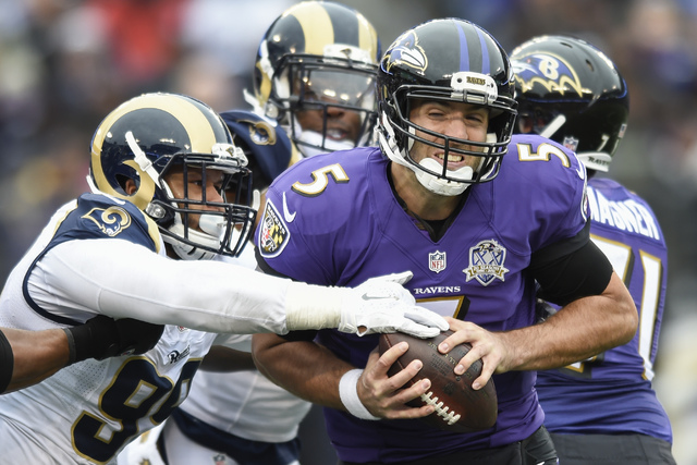 In this Nov. 22, 2015, file photo, Baltimore Ravens quarterback Joe Flacco (5) is sacked by St. Louis Rams defensive tackle Aaron Donald (99) during the first half of an NFL football game in Balti ...