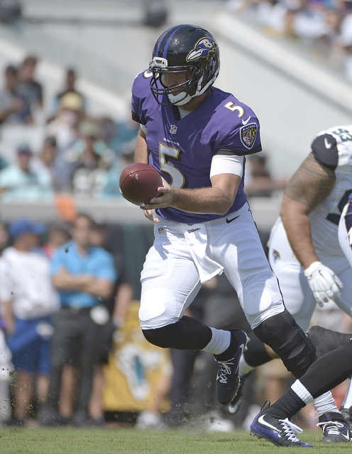 Baltimore Ravens quarterback Joe Flacco hands off the ball during the first half of an NFL football game against the Jacksonville Jaguars in Jacksonville, Fla., Sunday, Sept. 25, 2016. (AP Photo/P ...