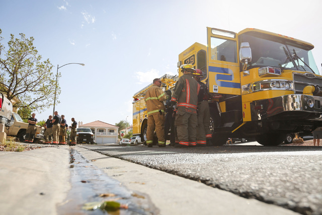 Clark County firefighters clean up after putting out a fire on Raven Wing Canyon Court in Las Vegas on Thursday, Sept. 22, 2016. Brett Le Blanc/Las Vegas Review-Journal Follow @bleblancphoto