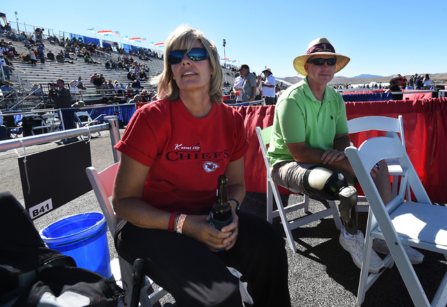 Linda Elvin of Overland Park, Kansas, left, and her husband, Brian, watch as a plane goes by during the Reno National Championship Air Races at Stead Airport in 2015.  (Jason Bean/The Reno Gazette ...