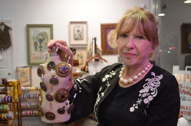 Vintage buttons are among the wares Carole Sidlow stocks at The Ribbon Store. Ginger Meurer/View