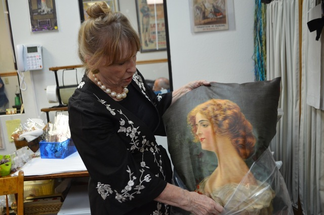 Among The Ribbon Store owner Carole Sidlow's favorite vintage collectibles at the 572 S. Decatur Blvd. store are chromolithograph printed pillow tops made from 1901 to 1909. Ginger Meurer/View