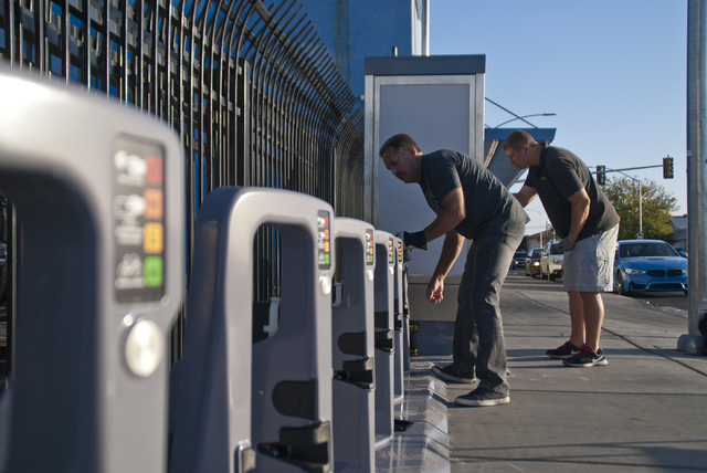 Viktor Schrecengost, right, and Jonny Cobb work to install a new bike-sharing station near Fremont Street and Maryland Parkway in downtown Las Vegas on Friday, Sept. 23, 2016. The Regional Transpo ...