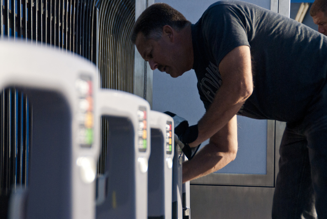 Jonny Cobb works to install a new bike-sharing station near Fremont Street and Maryland Parkway in downtown Las Vegas on Friday, Sept. 23, 2016. The Regional Transportation Commission (RTC) will s ...