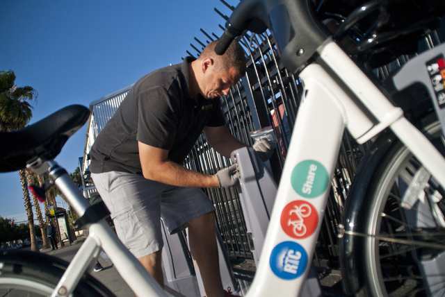 Viktor Schrecengost works to install a new bike-sharing station near Fremont Street and Maryland Parkway in downtown Las Vegas on Friday, Sept. 23, 2016. The Regional Transportation Commission (RT ...