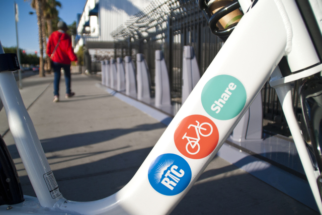A pedestrian walks by a new bike-sharing station near Fremont Street and Maryland Parkway in downtown Las Vegas on Friday, Sept. 23, 2016. The Regional Transportation Commission (RTC) will start a ...