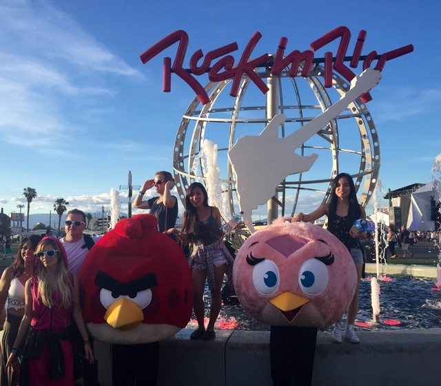 Fans pose with Angry Birds characters at the Rock in Rio fountain on Saturday, May 16, 2015. (Christopher Lawrence/Las Vegas Review-Journal)