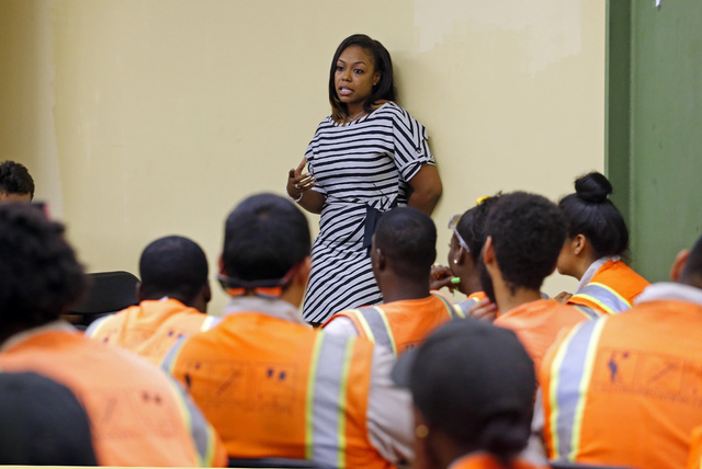 Rodney King's daughter Lora King, 32, speaks to a group of young people in downtown Los Angeles Thursday, Sept. 15, 2016. (Reed Saxon/The Associated Press)