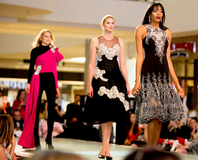 The fashion show culminated with an evening wear segment. The highlight was a jeweled pink Moschino top, paired with a DKNY bodysuit, pictured in rear.
