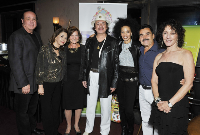 From left: Michael Vrionis, president, Universal Tone Management; Maria Santana Vrionis, Universal Tone Management and Milagro Foundation Board of Advisors; Dr. Elizabeth Fenjves; Carlos Santana;  ...