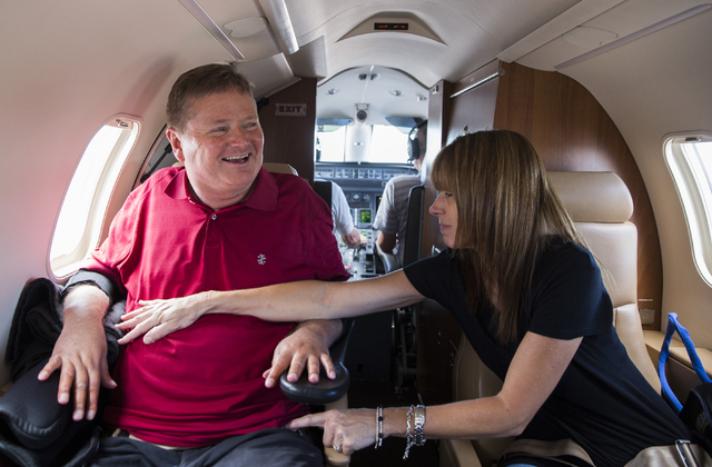 Sam Schmidt, left, is stabilized by wife Sheila during take off at West Coast Charters on Thursday, June 9, 2016, in Las Vegas. Schmidt, owner of IndyCar team Schmidt Peterson Motorsports, was en  ...