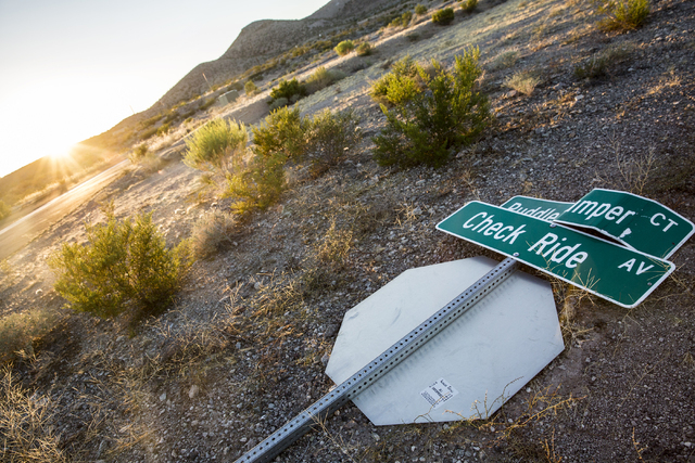A fallen street sign marking Puddle Jumper Court and Check Ride Avenue at Searchlight Airpark subdivision on Sunday, Sept. 4, 2016, in Searchlight, Nev. (Benjamin Hager/Las Vegas Review-Journal)