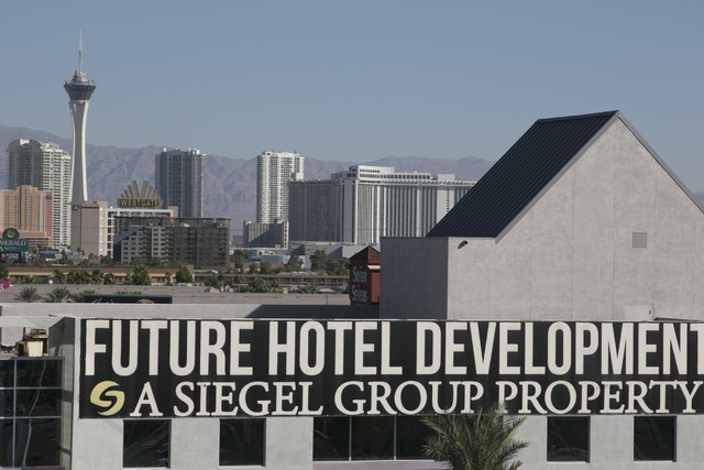A sign promising a future development hangs on the former Atrium Suites Hotel property located at 4255 Paradise Road in Las Vegas, Wednesday, Sept. 14, 2016. (David Becker/Las Vegas Review-Journal ...