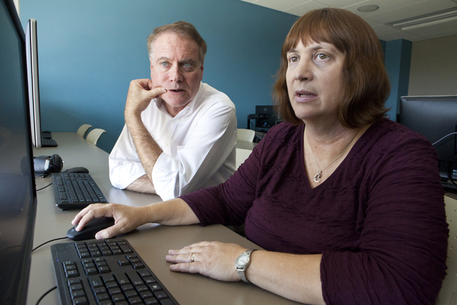 Film historian Jeff Crouse, left, and student editor Audrey Balzart review their documentary at Nevada State College in Henderson. (Loren Townsley/Las Vegas Review-Journal) Follow @lorentownsley