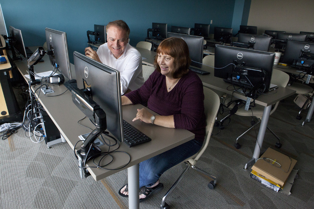 Film historian Jeff Crouse, left, and student editor Audrey Balzart review their documentary on silent movie actress Lassie Lou Ahern at Nevada State College's Henderson campus. (Loren Townsley/La ...
