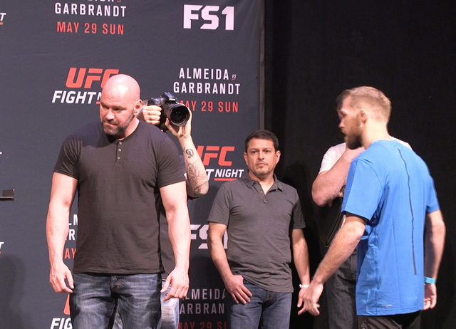 UFC president Dana White, UFC matchmaker Joe Silva (center), and bantamweight fighter Bryan Caraway wait for Aljamain Sterling to square off at the UFC Fight Night 88 weigh-ins. (Heidi Fang/Las Ve ...